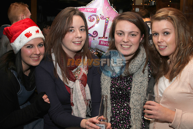 Amanda Heeney, Leah Mohan, Amie Hughes and Melissa Heeney on Christmas Eve in McPhails. ..(Photo credit should read Jenny Matthews www.newsfile.ie)....This Picture has been sent you under the conditions enclosed by:.Newsfile Ltd..The Studio,.Millmount Abbey,.Drogheda,.Co Meath..Ireland..Tel: +353(0)41-9871240.Fax: +353(0)41-9871260.GSM: +353(0)86-2500958.email: pictures@newsfile.ie.www.newsfile.ie.