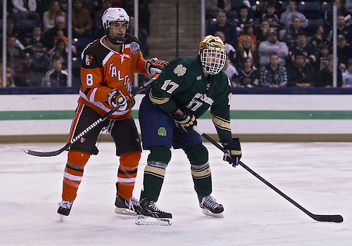March 02, 2013:  Notre Dame left wing Nick Larson (17) and Bowling Green defenseman Jose Delgadillo (8) battle for position during NCAA Hockey game action between the Notre Dame Fighting Irish and the Bowling Green Falcons at Compton Family Ice Arena in South Bend, Indiana.  Notre Dame defeated Bowling Green 4-1.
