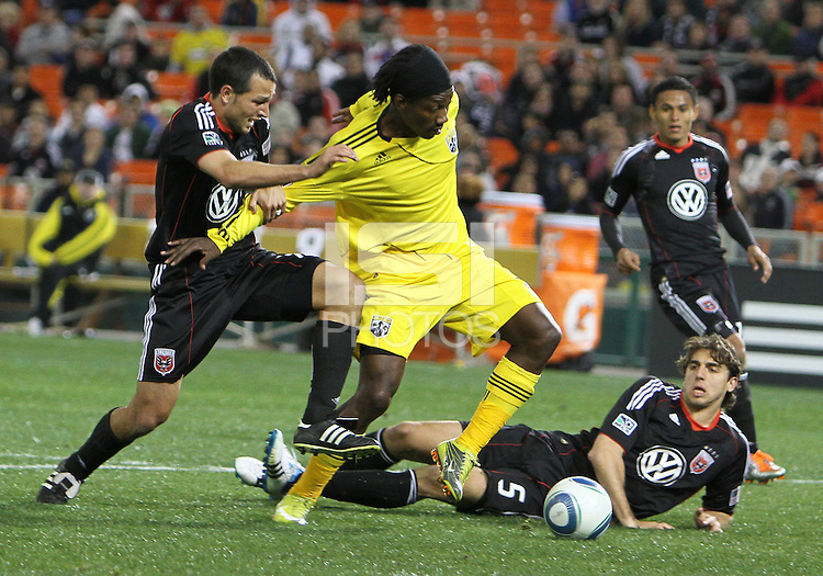 Jed Zayner#12 of D.C. United holds back Andres Mendoza#10 of the Columbus Crew during the opening match of the 2011 season at RFK Stadium, in Washington D.C. on March 19 2011.D.C. United won 3-1.