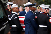 Former president George W. Bush watches as the flag-draped casket of former President George H.W. Bush is carried by a joint services military honor guard into a State Funeral at the National Cathedral, Wednesday, Dec. 5, 2018, in Washington. <br /> Credit: Alex Brandon / Pool via CNP