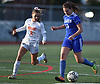 Kristen Dobkowski #15 of Calhoun, right, gets pressured by Caroline Mondiello #2 of Manhasset during a Nassau County Conference AB1 varsity girls soccer game at Calhoun High School on Tuesday, Oct. 16, 2018. The match, which was called with 9:57 remaining due to darkness, ended in a 1-1 tie.
