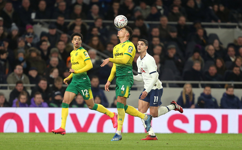 Norwich City's Ben Godfrey and Tottenham Hotspur's Erik Lamela<br /> <br /> Photographer Rob Newell/CameraSport<br /> <br /> The Emirates FA Cup Fifth Round - Tottenham Hotspur v Norwich City - Wednesday 4th March 2020 - Tottenham Hotspur Stadium - London<br />  <br /> World Copyright © 2020 CameraSport. All rights reserved. 43 Linden Ave. Countesthorpe. Leicester. England. LE8 5PG - Tel: +44 (0) 116 277 4147 - admin@camerasport.com - www.camerasport.com