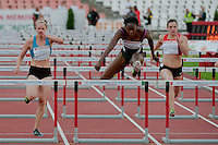 Yvette Lewis (R) from USA competes in 100m women's hurdles she won with 12.76 during the Istvan Gyulai Memorial Hungarian Athletics Grand Prix 2011, in the Ferenc Puskas Stadium in Budapest, Hungary on July 30, 2011. ATTILA VOLGYI