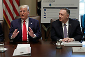 United States President Donald J. Trump speaks next to US Secretary of State Mike Pompeo (R) during a Cabinet Meeting at the White House in Washington, DC on October 21, 2019. <br /> Credit: Yuri Gripas / Pool via CNP