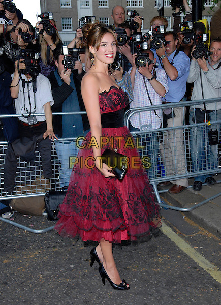 KELLY BROOK.Arrivals at the 4th Annual Glamour Women Of The Year Awards, Berkely Square Gardens, London, England. .June 5th 2007.full length red strapless dress black lace net netting fifties style prom shoes peep-toe bow waistband clutch purse .CAP/FIN.©Steve Finn/Capital Pictures