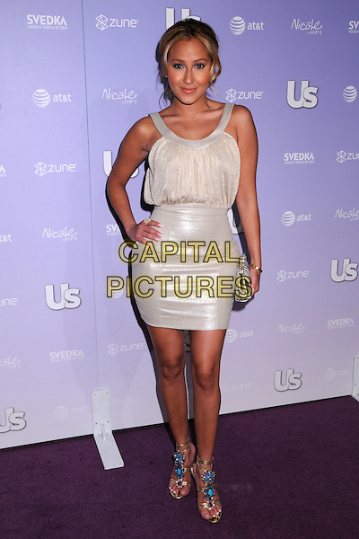 ADRIENNE BAILON.US Weekly's Hot Hollywood 2008 Party at Beso Restaurant, Hollywood, California, USA..April 17th, 2008.full length silver beige shiny skirt top gold hand on hip jewel encrusted beads beaded shoes sandals .CAP/ADM/BP.©Byron Purvis/AdMedia/Capital Pictures.