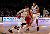 9th February 2018, Wiznik Centre, Madrid, Spain; Euroleague Basketball, Real Madrid versus Olympiacos Piraeus; Luka Doncic (Real Madrid Baloncesto) brings the ball foward against Kostas Papanikolaou (OLYMPIACOS BC)