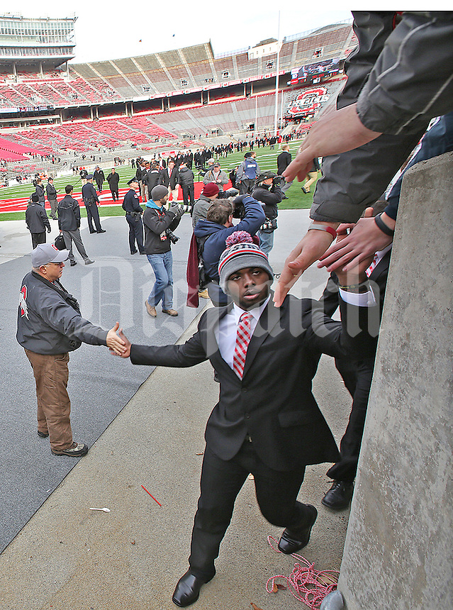 Ohio State Buckeyes quarterback J.T. Barrett (16) high fives ushers and fans as he and the team enter Ohio Stadium before the start of the game against Michigan  on November 29, 2014. (Chris Russell/Dispatch Photo)