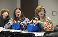 Dylan Rogers, 11, of Rogers learns how to use a tourniquet Wednesday, Feb. 26, 2020, during a Stop the Bleed class at Northwest Medical Center in Bentonville. The class, free for the public, taught participants how to use stop bleeding and save lives after a traumatic injury. Go to nwaonline.com/photos to see more photos.<br />