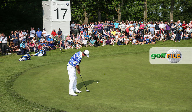 Scott Hend (AUS) sinks the putt for par during Round Three of the 2016 BMW PGA Championship over the West Course at Wentworth, Virginia Water, London. 28/05/2016. Picture: Golffile | David Lloyd. <br /> <br /> All photo usage must display a mandatory copyright credit to &copy; Golffile | David Lloyd.