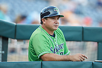 Gwinnett Stripers coach Einar Diaz (28) watches the action from the dugout during the game against the Scranton/Wilkes-Barre RailRiders at BB&T BallPark on August 16, 2019 in Lawrenceville, Georgia. The Stripers defeated the RailRiders 5-2. (Brian Westerholt/Four Seam Images)
