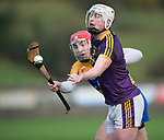 Liam Ryan of Wexford in action against Niall Deasy of Clare during the Jack Lynch Memorial game at Tulla. Photograph by John Kelly.