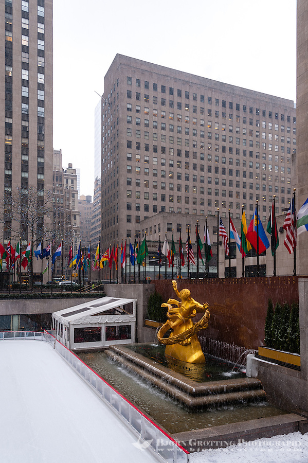 US, New York City. Rockefeller Center. The ice-skating rink outside the GE Building in snow weather.