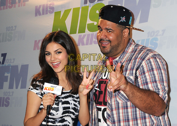 Victoria Justice, Chuey Martinez.at KIIS FM's Wango Tango 2013 held at The Home Depot Center, Carson, California, USA, 11th May 2013..arrivals half  length v peace sign hand gesture .CAP/ADM/BP.©Byron Purvis/AdMedia/Capital Pictures