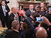 United States President Donald J. Trump autographs hats after addressing the 2018 Young Black Leadership Summit at The White House in Washington, DC on Friday, October 26, 2018.<br /> Credit: Chris Kleponis / Pool via CNP