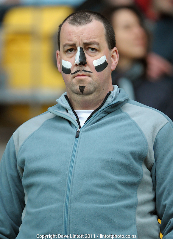 A face-painted fan during the South Africa versus Fiji pool D match of the 2011 IRB Rugby World Cup at Wellington Regional Stadium, Wellington, New Zealand on Saturday, 17 September 2011. Photo: Dave Lintott / lintottphoto.co.nz