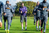 Thursday  13 October 2016<br /> Pictured: Head of Sports Science, Jonny Northeast leads a warmup session<br /> Re: Swansea City FC training session at the Fairwood training ground, Swansea, Wales, UK