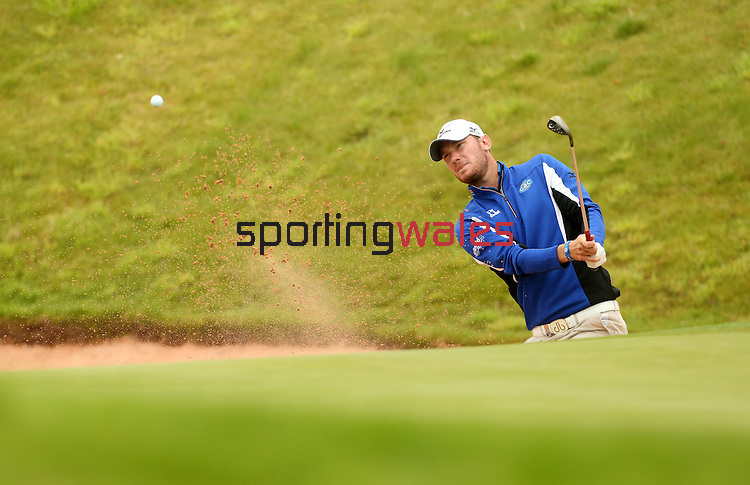 Chris Wood splashes out of the sand on the 18th during the first round of the ISPS Handa Wales Open 2013 at the Celtic Manor Resort<br /> <br /> 29.08.13<br /> <br /> ©Steve Pope-Sportingwales