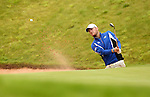Chris Wood splashes out of the sand on the 18th during the first round of the ISPS Handa Wales Open 2013 at the Celtic Manor Resort<br /> <br /> 29.08.13<br /> <br /> &copy;Steve Pope-Sportingwales