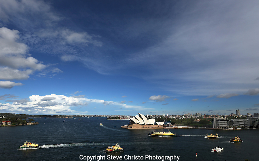 Ferries at work on Sydney Harbour infant of the Sydney Opera House.  Sydney, Australia. Monday, February 18th  2013. (Photo: Steve Christo).