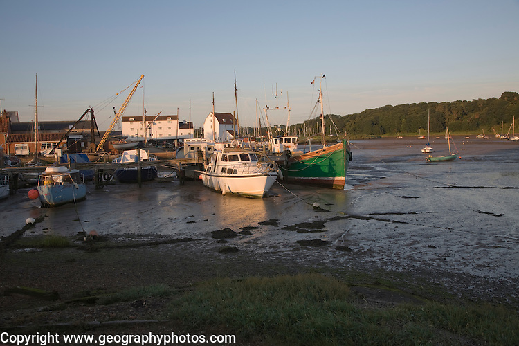 Boats at moorings at low tide, River Deben, Woodbridge, Suffolk, England