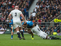 Twickenham, United Kingdom.   Maro ITOJE, in low on Michele CAMPAPNARO, during the  6 Nations International Rugby Match, England vs Italy at the RFU Stadium, Twickenham, England, <br /> <br /> Sunday  26/02/2017<br /> <br /> [Mandatory Credit; Peter Spurrier/Intersport-images]