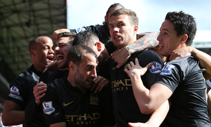 Manchester City's Edin Dzekoc celebrates scoring his sides first goal <br /> <br /> Photo by Kieran Galvin/CameraSport<br /> <br /> Football - Barclays Premiership - Crystal Palace v Manchester City - Sunday 27th April 2014 - Selhurst Park - London<br /> <br /> &copy; CameraSport - 43 Linden Ave. Countesthorpe. Leicester. England. LE8 5PG - Tel: +44 (0) 116 277 4147 - admin@camerasport.com - www.camerasport.com