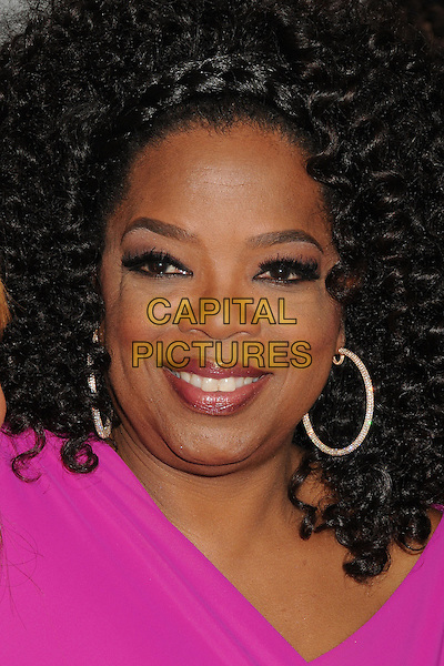 Oprah Winfrey<br /> &quot;Lee Daniels' The Butler&quot; Los Angeles Premiere held at Regal Cinemas L.A. Live, Los Angeles, California, USA.<br /> August 12th, 2013<br /> headshot portrait pink hoop earrings  <br /> CAP/ADM/BP<br /> &copy;Byron Purvis/AdMedia/Capital Pictures