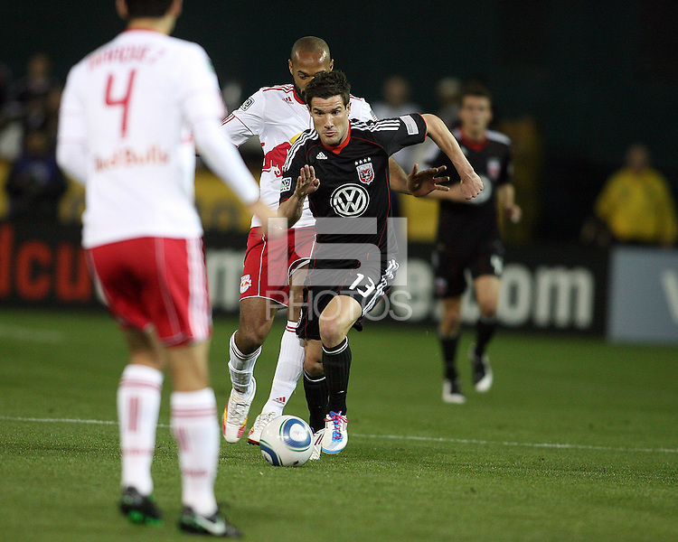 Chris Pontious (13) of D.C. United  runs towards Rafa Marquez (4) of the New York Red Bulls during an MLS match at RFK Stadium, in Washington D.C. on April 21 2011. Red Bulls won 4-0.
