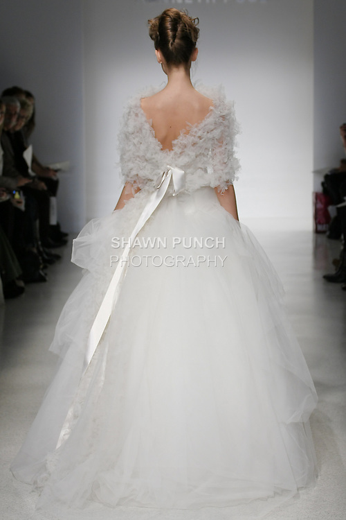 Model walks runway in a Daria wedding dresses by Amsale Aberra, for the Kenneth Pool Spring 2012 Bridal runway show.