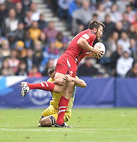 Wales's Adam Thomas is forced to pass the ball before a tackle comes in<br /> <br /> Australia Vs Wales - Men's quarter-final<br /> <br /> Photographer Chris Vaughan/CameraSport<br /> <br /> 20th Commonwealth Games - Day 4 - Sunday 27th July 2014 - Rugby Sevens - Ibrox Stadium - Glasgow - UK<br /> <br /> © CameraSport - 43 Linden Ave. Countesthorpe. Leicester. England. LE8 5PG - Tel: +44 (0) 116 277 4147 - admin@camerasport.com - www.camerasport.com