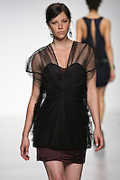 Model walks runway in an outfit from the In Flux collection by Gianna Lucci, during the Pratt 2011 fashion show. This collection won the Renee Hunter Eveningwear Award.