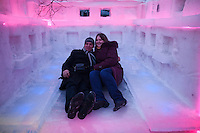 Moscow, Russia, 14/01/2012..A couple try the bed inside an ice hotel bedroom in Moroz City, or Frost City, an ice town constructed in Moscow's Sokolniki Park by a team of architects and ice sculptors. As well as ice sculptures the temporary town features a disco, hotel, fitness centre, post office and prison.
