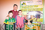Kerry footballer, Aidan O'Mahony with Mark and Jake Casey and the famous Sam Maguire.