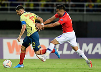 PEREIRA - COLOMBIA, 30-01-2020: Nicolas Benedetti de Colombia disputa el balón con Nicolas Diaz de Chile durante partido entre Colombia U-23 y Chile U-23 por la fecha 5, grupo A, del CONMEBOL Preolímpico Colombia 2020 jugado en el estadio Hernán Ramírez Villegas de Pereira, Colombia. /  Nicolas Benedetti of Colombia fights the ball with Nicolas Diaz of Chile during the match between Colombia U-23 and Chile U-23 for the date 5, group A, for the CONMEBOL Pre-Olympic Tournament Colombia 2020 played at Hernan Ramirez Villegas stadium in Pereira, Colombia. Photo: VizzorImage / Cristian Alvarez / Cont