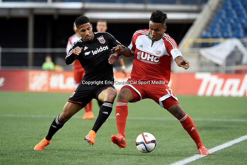 May 23, 2015 - Foxborough, Massachusetts, U.S. - New England Revolution forward Juan Agudelo (17) and D.C. United defender Sean Franklin (5) battle for possession of the ball during the MLS game between DC United and the New England Revolution held at Gillette Stadium in Foxborough Massachusetts. The New England Revolution and D.C. United ended the game tied 1-1.  Eric Canha/CSM
