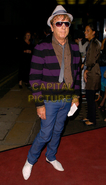 "NICKY HASLAM.""The Queen"" UK premiere, Curzon Mayfair, London, UK..September 13th, 2006.Ref: CAN.full length jeans denim purple black striped stripes cardigan tie hat sunglasses shades.www.capitalpictures.com.sales@capitalpictures.com.©Can Nguyen/Capital Pictures"