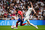 Gareth Bale of Real Madrid (R) fights for the ball with Thomas Lemar of Atletico de Madrid (L) during their La Liga  2018-19 match between Real Madrid CF and Atletico de Madrid at Santiago Bernabeu on September 29 2018 in Madrid, Spain. Photo by Diego Souto / Power Sport Images