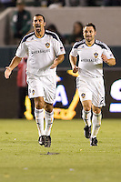 LA Galaxy forward Jovan Kirovski (l) and teammate midfielder Dema Kovalenko (r) celebrate a goals together. The LA Galaxy defeated the Columbus Crew 3-1 at Home Depot Center stadium in Carson, California on Saturday Sept 11, 2010.
