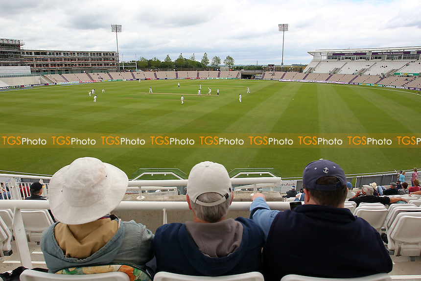 Spectators look on during Day One - Hampshire CCC vs Essex CCC - LV County Championship Division Two Cricket at the Ageas Bowl, West End, Southampton - 15/06/14 - MANDATORY CREDIT: Gavin Ellis/TGSPHOTO - Self billing applies where appropriate - 0845 094 6026 - contact@tgsphoto.co.uk - NO UNPAID USE