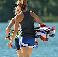 Banyoles, SPAIN,   Netherlands competitors carry their blades to the boat ing area, FISA World Cup Rd 1. Lake Banyoles  Thursday,  28/05/2009   [Mandatory Credit. Peter Spurrier/Intersport Images]
