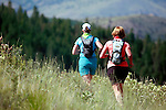 Two women enjoying the trail running experience at Echo Ridge in the Lake Chelan Valley