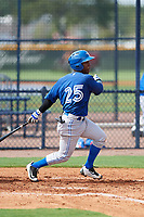 GCL Blue Jays second baseman Jose Theran (18) follows through on a swing during the first game of a doubleheader against the GCL Yankees East on July 24, 2017 at the Yankees Minor League Complex in Tampa, Florida.  GCL Blue Jays defeated the GCL Yankees East 6-3 in a game that originally started on July 8th.  (Mike Janes/Four Seam Images)