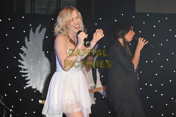 Natasha Bedingfield and Leona Lewis.'Global Angels Awards', The Park Plaza Hotel, Westminster, London, England. 2nd December 2011..music on stage live concert gig performing half length microphone singing strapless white dress black jacket hand arm duet .CAP/MAR.© Martin Harris/Capital Pictures.