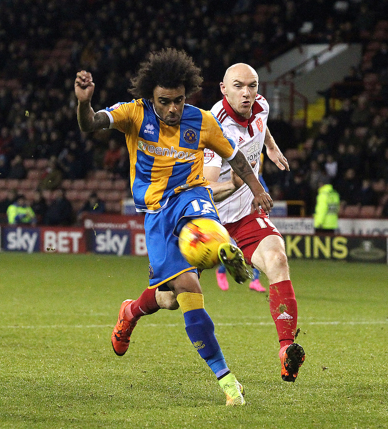 Shrewsbury Town's Junior Brown shields the ball from Sheffield United's Conor Sammon<br /> <br /> Photographer Rich Linley/CameraSport<br /> <br /> Football - The Football League Sky Bet League One - Sheffield United v Shrewsbury Town - Tuesday 24th November 2015 - Bramall Lane - Sheffield<br /> <br /> &copy; CameraSport - 43 Linden Ave. Countesthorpe. Leicester. England. LE8 5PG - Tel: +44 (0) 116 277 4147 - admin@camerasport.com - www.camerasport.com