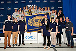 GREENSBORO, NC - MARCH 17: The NCAA Champion Queens University of Charlotte Royals Men's Swimming and Diving team poses with the NCAA champion's trophy atop the awards stand following the conclusion of the Division II Men's and Women's Swimming & Diving Championship held at the Greensboro Aquatic Center on March 17, 2018 in Greensboro, North Carolina. (Photo by Mike Comer/NCAA Photos/NCAA Photos via Getty Images)