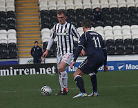 David Barron closed down by Iain Vigurs in the St Mirren v Ross County Clydesdale Bank Scottish Premier League match played at St Mirren Park, Paisley on 19.1.13.