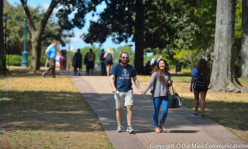 Senior Alex Hargett and PY2 student Lynn Tran walk through the Grove. Photo by Thomas Graning/Ole Miss Communications