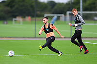 Matt Grimes battles with Jay Fulton of Swansea City during the Swansea City Training Session at The Fairwood Training Ground, Wales, UK. Tuesday 11th September 2018