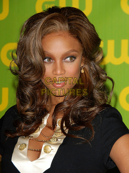TYRA BANKS.The CW Launch Party held at Warner Brothers' Studios in Burbank, California, USA..September 18th, 2006.Ref: DVS.headshot portrait white gold buttons.www.capitalpictures.com.sales@capitalpictures.com.©Debbie VanStory/Capital Pictures